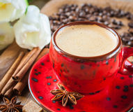 Cup of coffee on  decorated with spices Royalty Free Stock Image