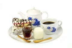 Cup of coffee and delicious cake Stock Photos