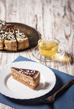 Cup of coffee and delicious cake on wooden table Royalty Free Stock Photography