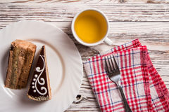 Cup of coffee and delicious cake on wooden table Stock Photography