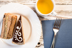 Cup of coffee and delicious cake on wooden table Royalty Free Stock Photos