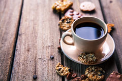 Cup of coffee with a delicious chocolate and cookies on a wooden background Stock Photo