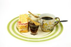 Cup of coffee and delicious orange cake Royalty Free Stock Photos