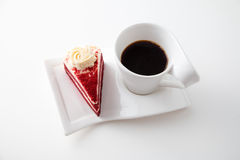 Cup of coffee with delicious red velvet cake. Isolated on white background Stock Photos