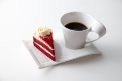 Cup of coffee with delicious red velvet cake. Isolated on white background Stock Photography