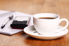 Cup of coffee on the desk. Cup of hot coffee on the desk royalty free stock photos