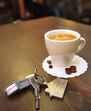 Cup of coffee on the desk  and  keys. Cup of coffee on the desk  and house keys Royalty Free Stock Photo