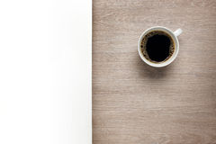 Cup of coffee on desk with white space Royalty Free Stock Photo