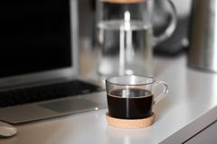 A cup of coffee on the desktop stock images