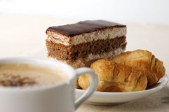 Cup of coffee with dessert Stock Photos
