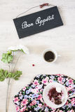 Cup of coffee with dessert and book on the table Royalty Free Stock Photos