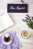 Cup of coffee with dessert and notebook on the table Royalty Free Stock Photos