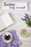 Cup of coffee with dessert and notebook on the table Royalty Free Stock Photography
