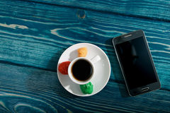 Cup of coffee, dessert and phone Stock Photos