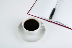 Cup of coffee with diary with fountain pen Royalty Free Stock Photography