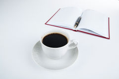 Cup of coffee with diary with fountain pen Royalty Free Stock Images