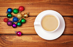 Cup of coffee and different christmas bubbles Royalty Free Stock Photos