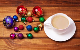 Cup of coffee and different christmas bubbles Stock Image