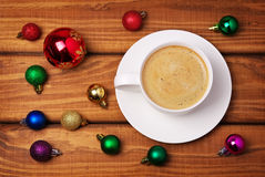 Cup of coffee and different christmas bubbles Royalty Free Stock Images