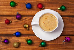 Cup of coffee and different christmas bubbles Stock Photo