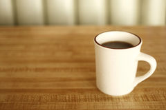 Cup of coffee at diner. A cup of coffee on the table at a diner Stock Photos