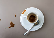 Cup of coffee in dirty table Stock Images