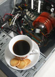 Cup of coffee and a disassembled computer Stock Images