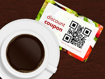Cup of coffee with discount coupon Stock Image