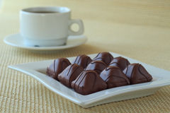 Cup of coffee and chocolate candies Stock Photos