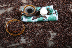 Cup of coffee on a dish towel Stock Photos