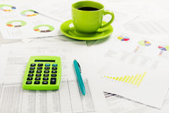 Cup of coffee on document. Accounting Royalty Free Stock Photo