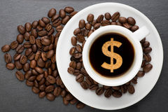 Cup of coffee with dollar Stock Photo