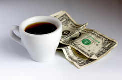 Cup of coffee and dollars Royalty Free Stock Photos