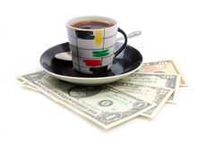 Cup of the coffee and dollars Royalty Free Stock Photo