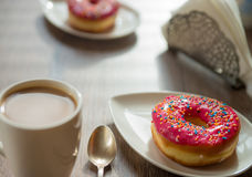 Cup of coffee and donaughts on the table Stock Photography