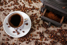 Cup of Coffee is done on old iron mill Stock Image