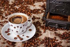 Cup of Coffee. done on old iron mill machine. Royalty Free Stock Photo