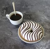 A cup of coffee and a donut Royalty Free Stock Photo
