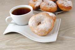 A cup of coffee and donuts Stock Image