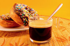 Cup of coffee with donuts Royalty Free Stock Image