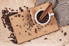 Cup of coffee with drawing of coffee beans Royalty Free Stock Photos
