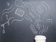Cup of coffee with drawing steam on the blackboard from the top Stock Images
