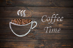 Cup of coffee drawn with chalk on the old vintage wooden board. Royalty Free Stock Image
