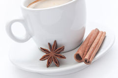 Cup of coffee with dried anis and cinnamon. On white background royalty free stock photos