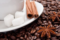 Cup of coffee with dried anis and cinnamon. On white background stock photos