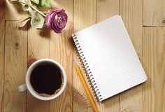 Cup of coffee, dried roses and notebook Stock Images