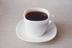 A Cup of coffee. Drink morning cheerfulness energy white background saucer break Stock Photo