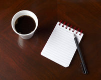 Cup of coffee drink notebook pencil business. Close up of coffee cup and notebook with pencil on table Stock Photos