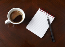 Cup of coffee drink notebook pencil business. Close up of coffee cup and notebook with pencil on table Stock Image