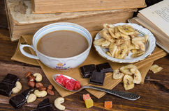 Cup of coffee with dry fruits and chocolate on napkin stock images